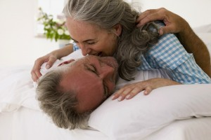 Older-couple-laughing-in-bed_shutterstock_199823570_72